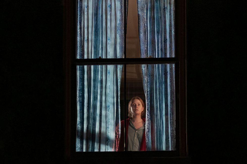 Kobieta w oknie 5